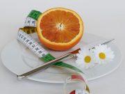 Orange mit Massband